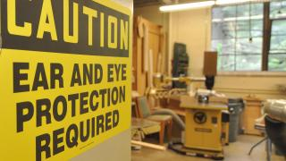 Ear & Eye Protection Caution Sign in the Carpentry Shop